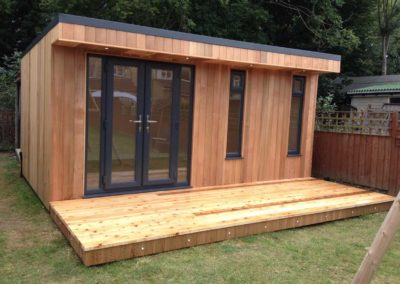 angled garden room with double deck and narrow vertical windows