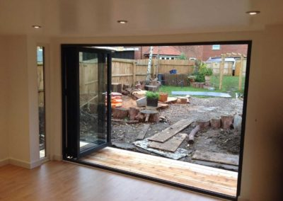 inside garden room with large folding door open