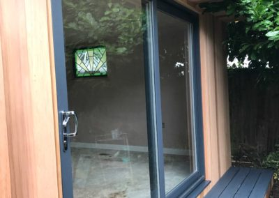 angled garden room with small grey step