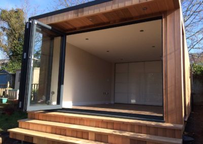 Garden room with external folding door and interior sliding door