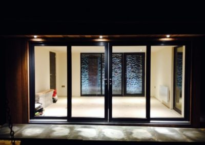 garden room with sliding doors and internal lights on