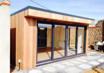 garden room front on concrete base with sliding doors