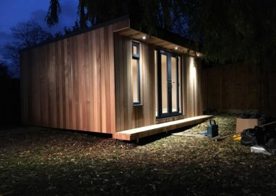 Angled garden room with lights on