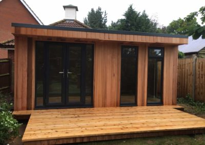 garden room with deck and double doors