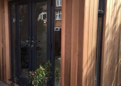 front right corner of garden room showing double doors and narrow vertical window