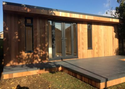large garden room with grey deck