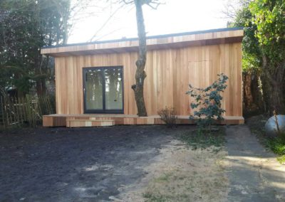 Garden room with deck built around tree