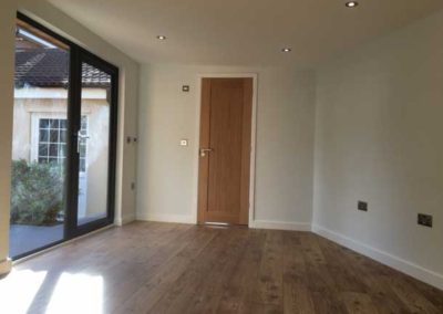 Inside large garden room with power sockets