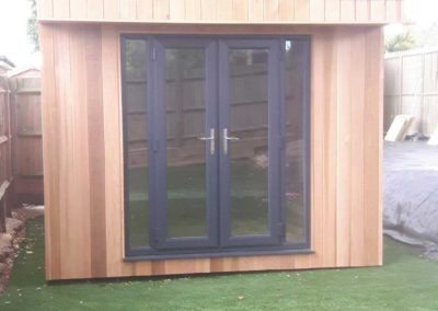 Front of small garden room with double doors