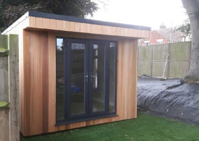 Angled front of garden room with double doors