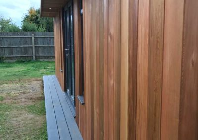 Length view of garden room with grey step