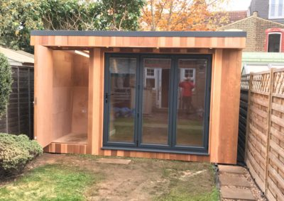 garden room with folding door entrance and storage entrance open