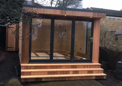 garden room with steps and folding door