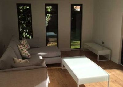 Inside large garden room lounge view