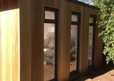 Closeup side of large garden room with windows