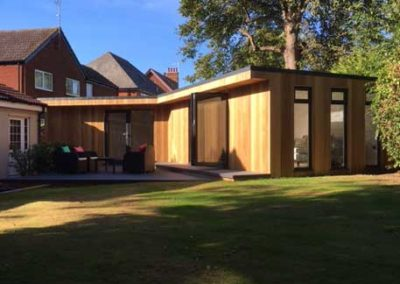 Side of large garden room with windows