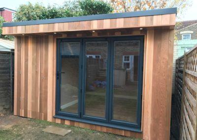 garden room with folding door entrance and storage entrance closed