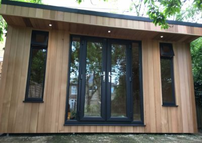 Garden room with double doors and narrow vertical windows