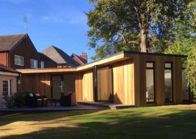 Far shot of large garden room with folding door and second entrance