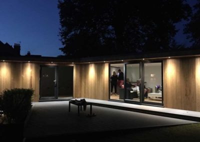 Large garden room with large grey deck and spotlights