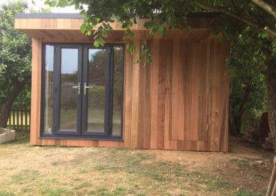 Front garden room with main double door and blended second entrance