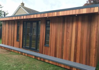 Large garden room with long grey step deck