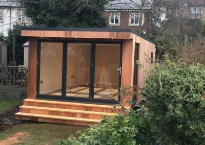 Angled garden room with step deck