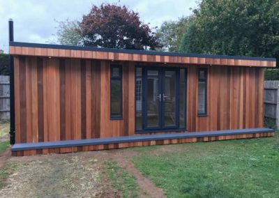 Completed large garden room with double doors and vertical windows