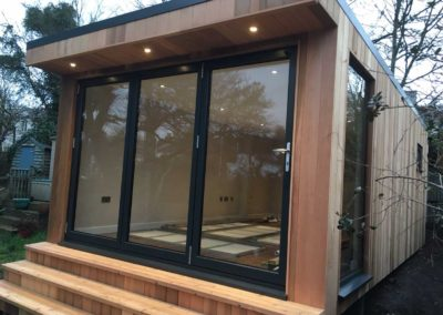 garden room with deck step and large side window