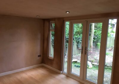 Garden room interior with plug socket