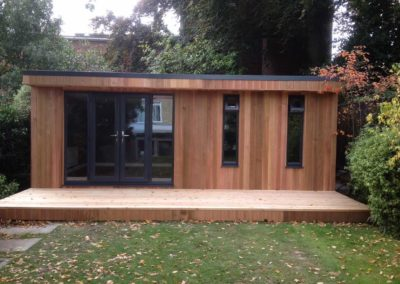 Completed garden room with double doors and large deck