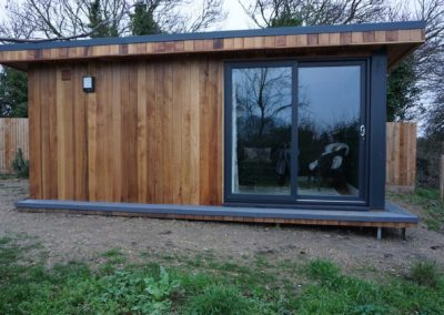 Garden room office with sliding door