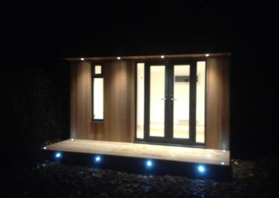 Small garden room with double doors and spotlights