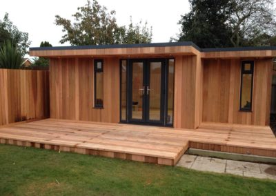 Garden room with matching fence