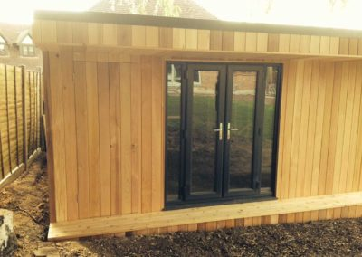 garden room with small deck step