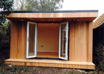 Front view of small garden room with open double doors