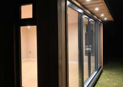 Side of garden room with canopy lights