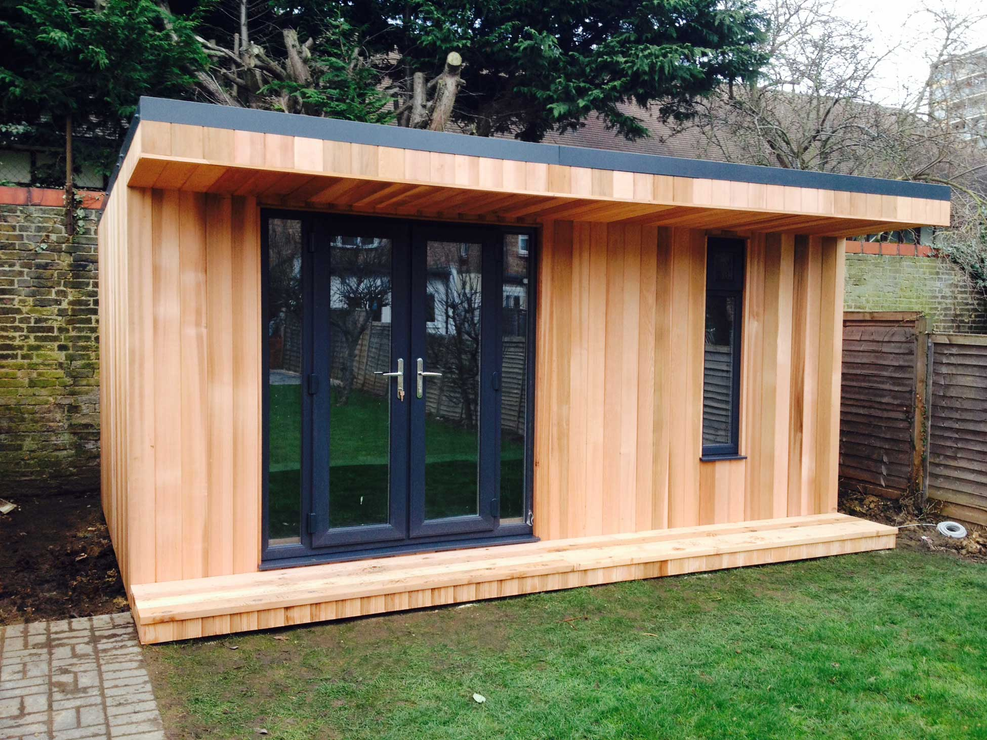 garden room with double doors and narrow vertical window