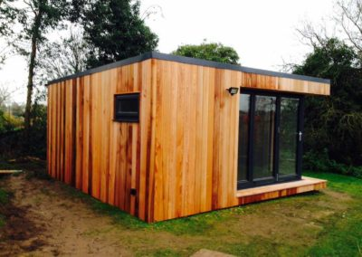 Front left angled garden room with window