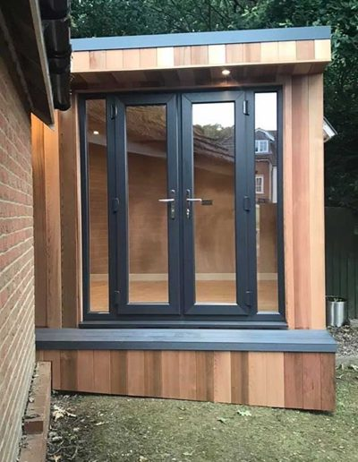 Garden room with double doors and grey step deck