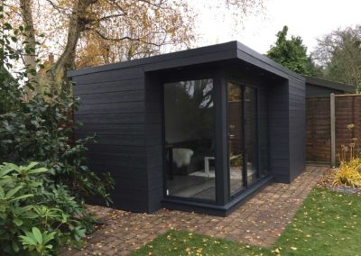 Grey garden room with large windows side