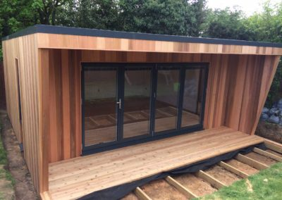 Angled garden room with deck under construction
