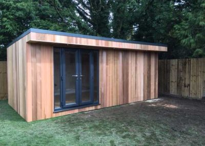 Garden room with main entrance and side storage door closed
