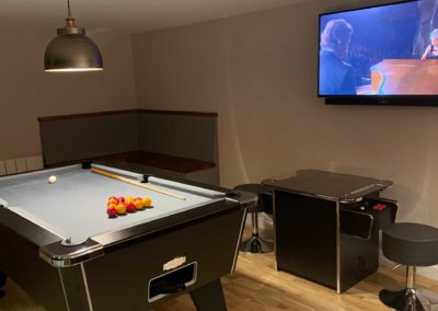 Inside garden room with pool table and TV
