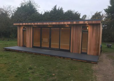 Angled large garden room with large windows