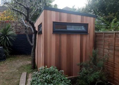 Small garden room nest to plant beds and tree