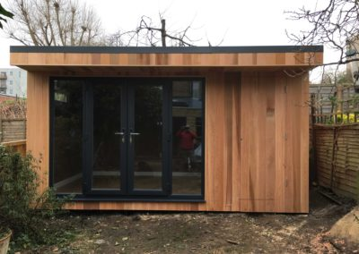 Garden room with double doors and storage entrance