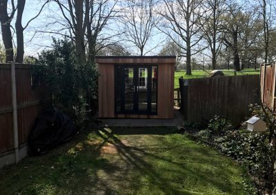 Garden room next to fence on patio