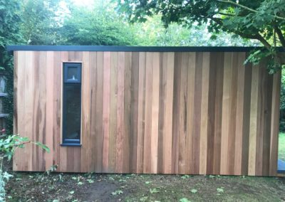Side of garden room with single vertical window