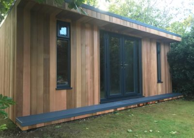 Front angled gardenroom with grey double doors